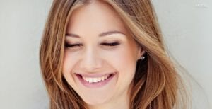 Caucasian Female With Honey Colored Hair Smiling With Eyes Closed - Tablet Homepage