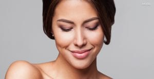 Female With Dark Brown Hair And Big Lips Looking Down Over Bare Upper Chest - Tablet Homepage