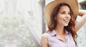 Female Wearing Sun Hat and Striped Shirt Outside In Garden - Gallery Slider Background For Desktop