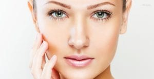 Headshot of Female With Green Eyes Holding Hand To Chin - Botox Homepage for Tablet