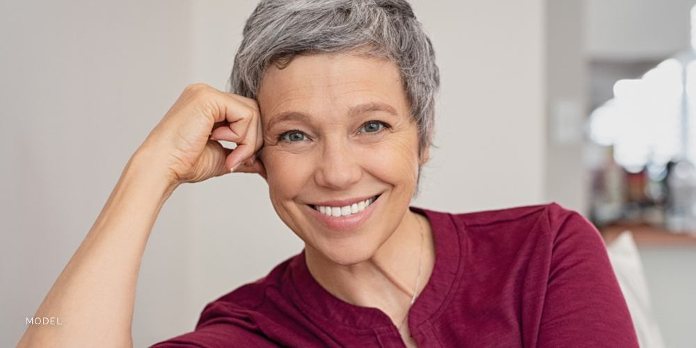 Mature Caucasian Female With Short Gray Hair Wearing Magenta Tunic Shirt